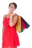 Portrait of stunning young woman with shopping bag. Portrait of stunning young woman carrying shopping bags against white background Stock Photos