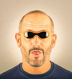 Portrait of a stupid Man with too small Sunglasses. Portrait of a stupid Man with too Sunglasses which appear to be to small royalty free stock photography