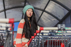 Portrait of stylish Asian girls near small cart Royalty Free Stock Images