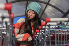 Portrait of stylish Asian girls near small cart Royalty Free Stock Photos