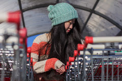 Portrait of stylish Asian girls near small cart Royalty Free Stock Photography
