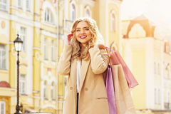 Portrait of stylish, beautiful blonde hair smiling girl with shoppings. Happy shopping. Stock Photo