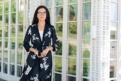 Portrait of a stylish beautiful European woman wearing eyeglasses in a fashionable setting. Business lady wears a