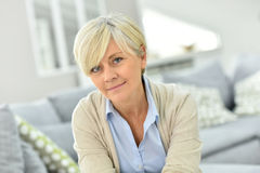 Portrait of stylish beautiful senior woman at home royalty free stock photography