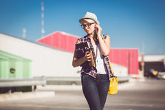 Portrait of stylish blonde girl posing on street at sunny day Stock Image