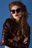 Portrait of stylish brunette female model in sunglasses Royalty Free Stock Photo