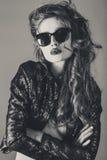 Portrait of stylish brunette female model in sunglasses Stock Image