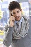 Portrait of stylish businessman on mobile Stock Photos