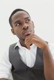 Portrait of stylish businessman thinking Stock Photo
