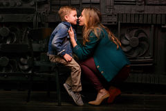 Portrait of stylish cute little boy with beautiful mom. In photo studio Stock Images