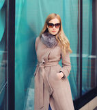 Portrait of stylish elegant woman in coat and sunglasses Royalty Free Stock Images