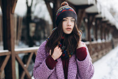 Portrait stylish fashionable and beautiful girl in snowy weather. Royalty Free Stock Photos