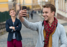 Portrait of stylish fashionable young man staying on the street Stock Images
