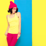 portrait of a stylish girl on a colored background Stock Photo
