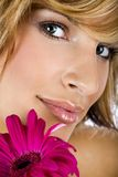 Portrait of a stylish girl with flower. Close up portrait of a stylish girl with flower royalty free stock photography