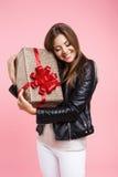 Portrait of stylish girl holding big gift on birthday Royalty Free Stock Photography