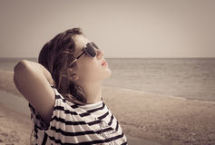 Portrait of a stylish girl relaxing on the beach Royalty Free Stock Images