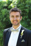 Portrait of a stylish groom smiling Stock Photos