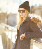 Portrait stylish hipster girl in a warm sunny day Royalty Free Stock Photography