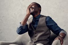 portrait of stylish laughing african american man stock image