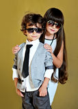 Portrait of stylish little boy and girl Royalty Free Stock Image