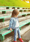 Portrait of stylish little girl child in the jeans clothes Stock Image