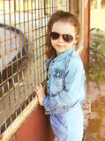 Portrait of stylish little girl child wearing a jeans clothes Stock Photography
