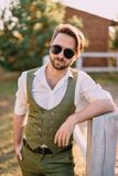 Portrait stylish man on background of ranch royalty free stock images