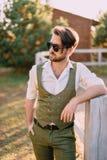Portrait stylish man on background of ranch royalty free stock photos