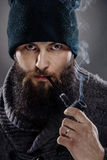 Portrait of a stylish man with beard and pipe Stock Images