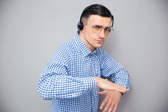 Portrait of a stylish man in glasses and headphones Stock Photography