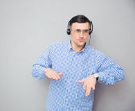 POrtrait of a stylish man in glasses and headphones Stock Photos