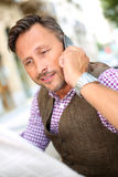 Portrait of stylish man talking on phone outdoor Stock Photos