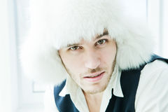 Portrait of stylish man wearing a fur trendy hat Royalty Free Stock Photography