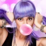 Beauty Stylish Party Girl. Purple Wig and Bubble Gum Stock Photos