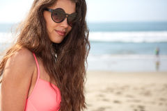 Portrait of a stylish sexy girl in sunglasses. And jeans shorts Stock Images