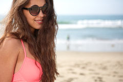 Portrait of a stylish sexy girl in sunglasses. And jeans shorts Royalty Free Stock Photos