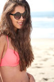 Portrait of a stylish sexy girl in sunglasses. And jeans shorts Stock Image