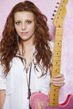 Portrait of stylish teenage girl holding guitar Royalty Free Stock Photos