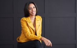 Teenage girl smiling in yellow leather jacket royalty free stock image