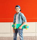 Portrait stylish teenager boy with skateboard in city Royalty Free Stock Photos