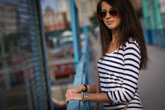 Portrait of stylish woman with glasses on the street Royalty Free Stock Photography