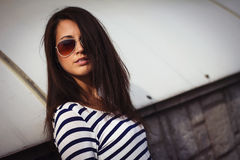 Portrait of stylish woman with glasses on the street Royalty Free Stock Image