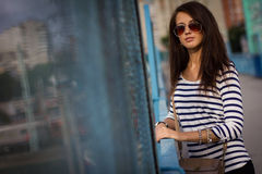 Portrait of stylish woman with glasses on the street Stock Photos