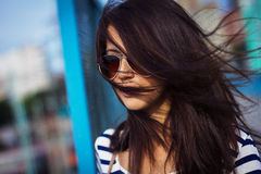 Portrait of stylish woman with glasses on the street Royalty Free Stock Photos