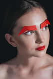 Portrait of stylish woman with red lips and paper brows posing for fashion shoot Royalty Free Stock Photo