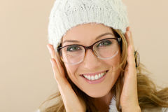 Portrait of stylish woman with winter hat and glasses royalty free stock photo