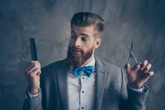 Portrait of Stylish young bearded man in a suit with bow-tie sta royalty free stock photos