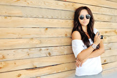 Portrait of stylish young brunette woman in casual clothes with Stock Photos