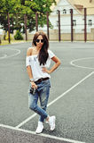 Portrait of stylish young brunette woman in casual clothes with Royalty Free Stock Photo